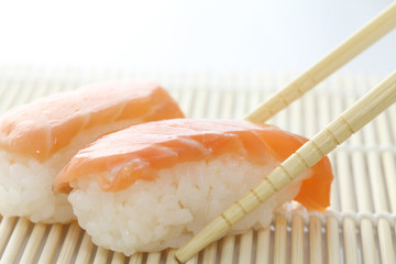 Salmon sushi with chopsticks