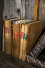 Antique books on a book shelf