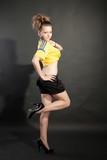 Pretty model posing in Ukraine soccer jersey in studio