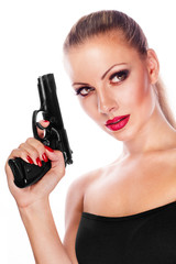 Young beautiful woman holding a gun