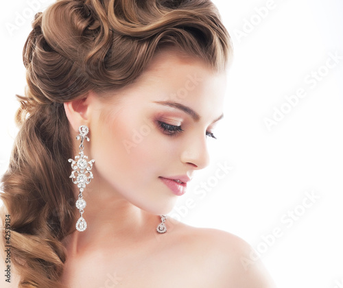 Beautiful female wedding model isolated on white background