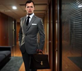 Businessman in a hallway