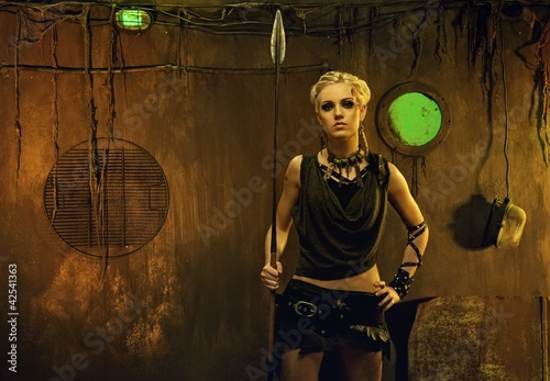 Woman with a spear in a bunker