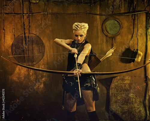 Woman with a bow in a bunker