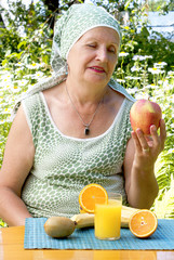 The adult woman and fruit