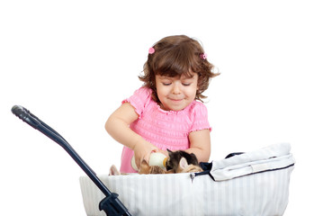child playing and feeding kitten