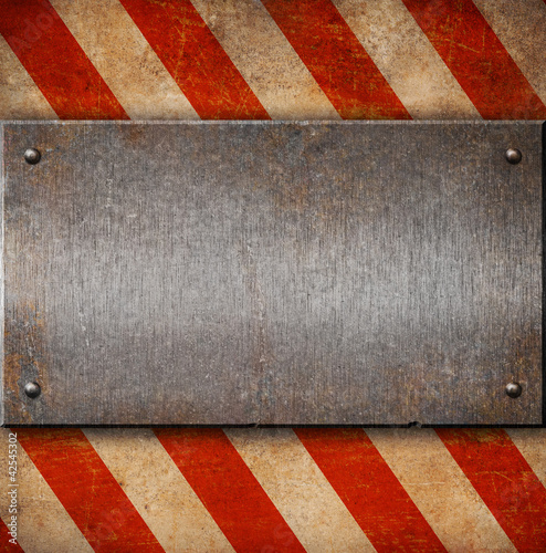 Grunge metal plate with white and red stripes