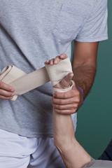 Therapist applying Bandage on the Hand