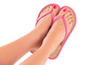 Female feet with flip-flops, isolated on white background.