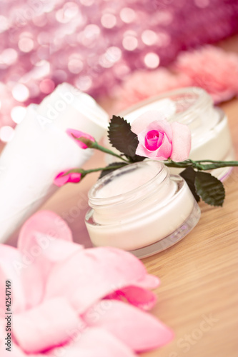 luxury spa products and pink flowers
