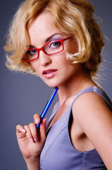 businesswoman in red glasses
