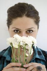 girl smelling white flowers