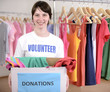 Volunteer with clothing donation