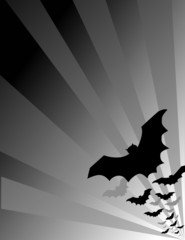 Halloween bats flying out at night, copy space.