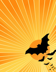 Halloween bats flying out at sunset, copy space.