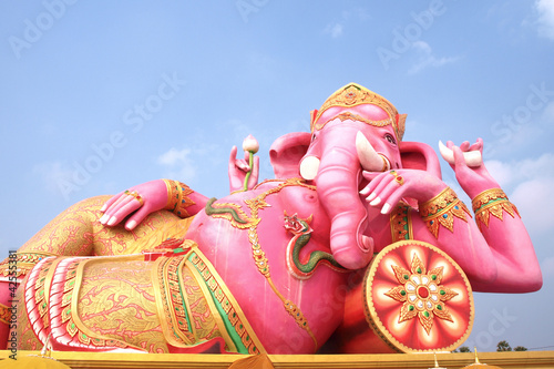 Big pink Ganesha in relaxed pose, From temple in Thailand