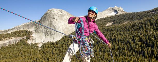 Female climber rappellling.