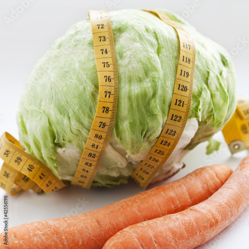 carrots, cabbage and measuring tape