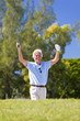 Happy Senior Man Celebrating Playing Golf