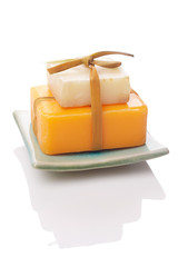 white and orange soaps