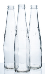 Three empty bottles on a white background.
