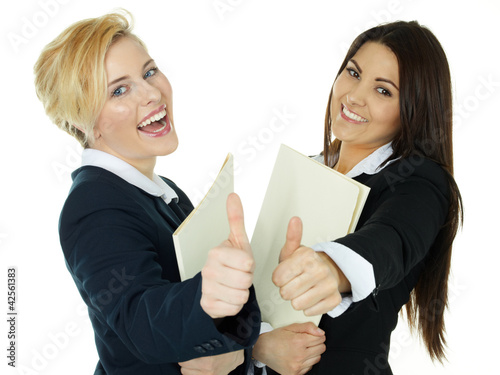 Girls with application file showing thumb up getting the job