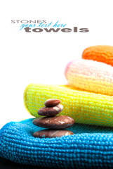 Stack of towels and stones.