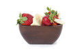 strawberries and banana slices in bowl