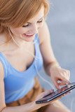 Attractive woman using digital tablet outdoors
