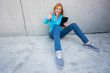 Woman with digital tablet and thumbs up