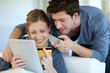 Young couple at home buying on internet