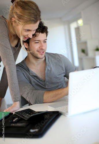 Young people studying from home with laptop computer