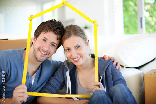 Portrait of happy young property owners