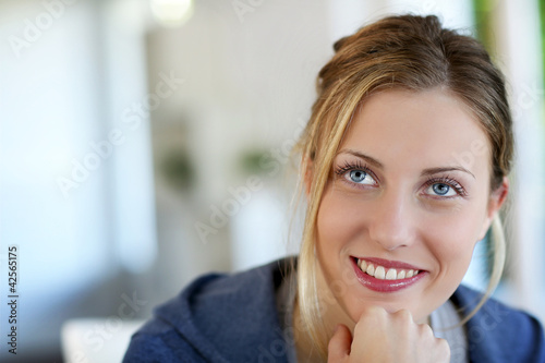Portrait of beautiful teen girl with blue eyes