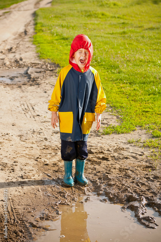 Boy in a muddy puddle