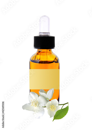bottle with essence oil and jasmine flower isolated on white