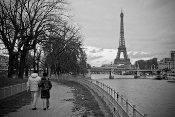 Couple Walking along La Seine with Eiffel Tower in view