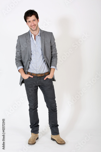 Young man standing on white background