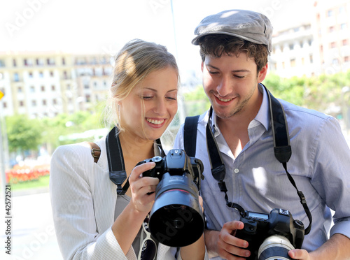 Couple of photographers looking at snapshots