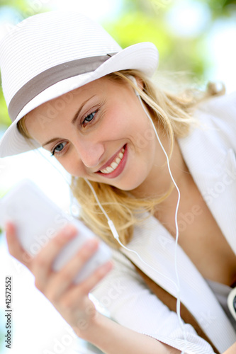 Attractive young blond girl using smartphone