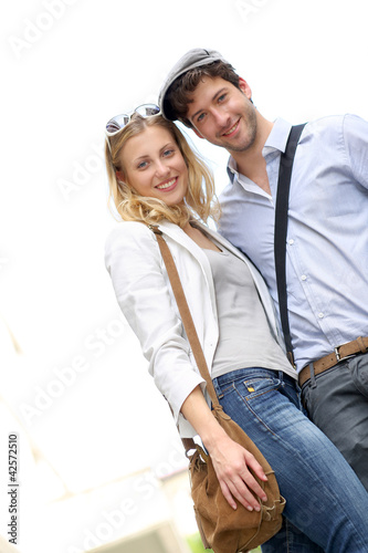 Portrait of lovely couple standing outside