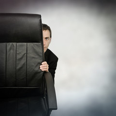 hiding businessman