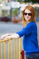Style redhead girl at the street