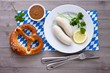 White sausages with sweet mustard and pretzel