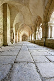 Old colonnaded closter in the Abbaye de Fontenay - 42574351