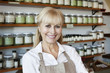 Portrait of a happy senior female employee in spice store