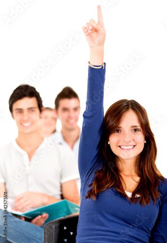 Student in class raising hand