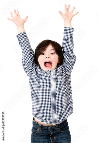 Excited boy with arms up