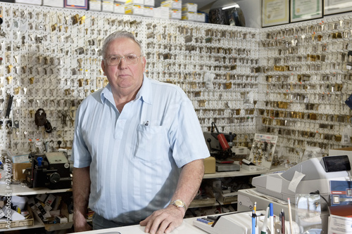 Portrait of locksmith in store