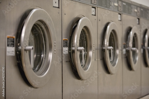 Row of self-service clothes dryer's door